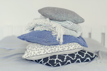 Pile Of Pillows On The Edge Of...