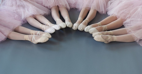 Ballerinas legs in pointe shoes on floor