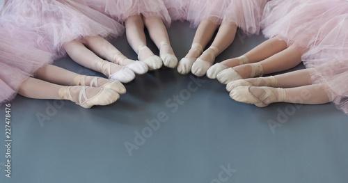 Ballerinas legs in pointe shoes on floor