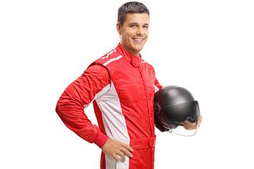 Fototapeta Racer holding a helmet and smiling