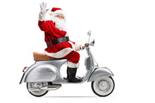 Santa Claus Riding A Vintage Motorbike And Waving