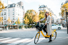 Portrait Of A Young Stylish Woman With Yellow Bicycle On The Street In Paris
