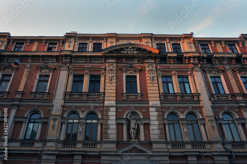 Foto  The old building during red sunset. Europe