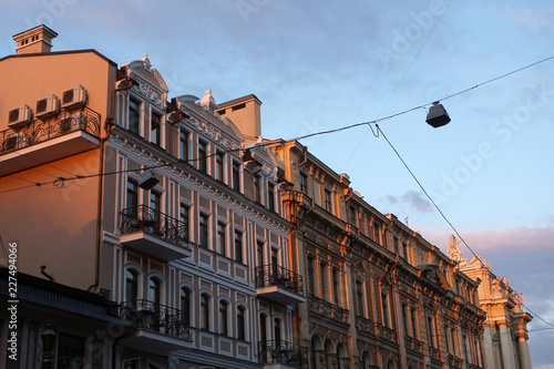 Fotografie, Tablou  The old building during red sunset. Europe