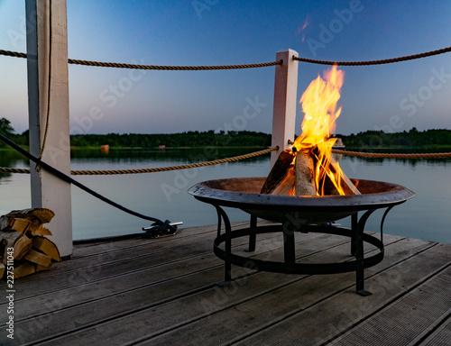 Feuer in einer Feuerschale am Abend am See Canvas Print