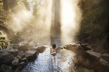 Woman Relaxing In Hot Spring At Forest