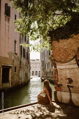 Fototapeta traveling woman in venice italy with long hair obraz