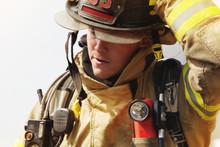 Close-up Of Firefighter Wearing Helmet