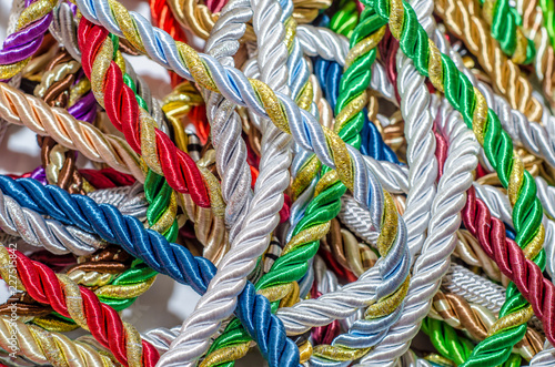 Foto op Aluminium Paradijsvogel bloem Multicolored thick ropes, chaos. Textile manufactory, home decoration, holiday.