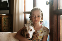 Portrait Of Girl With Dog At Home