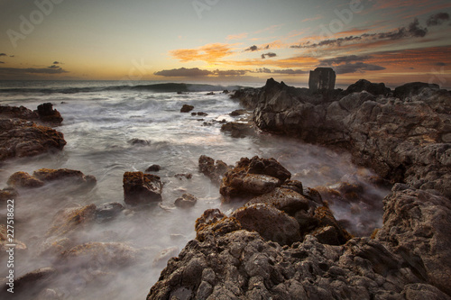 Scenic view of shore during sunset