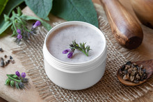 A Jar Of Homemade Comfrey Root Ointment With Fresh Symphytum Plant