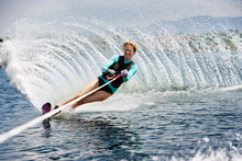 Woman Wakeboarding Under Wave