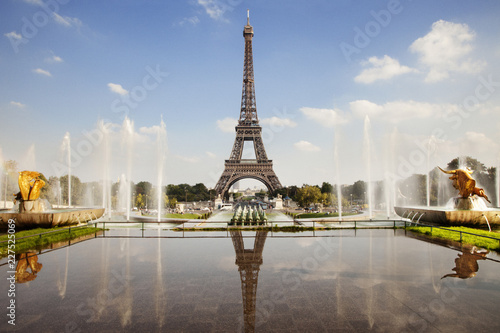 Reflection of Eiffel Tower seen in pond against sky - 227525069