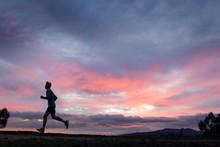 Athlete Running In Field At Su...