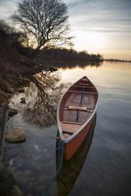 Boat Moored On Lake Against At...
