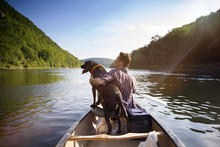 Man With Dog In Canoe