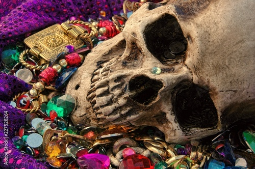 Dreams of avarice, skull among a heap of jewels and gold. Wallpaper Mural