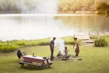 Family Preparing Campfire On F...