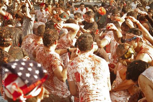 People enjoying La Tomatina festival in Spain