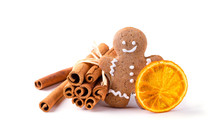 Gingerbread Man With Cinnamon Sticks And Dried Orange Slice Isolated On White Background