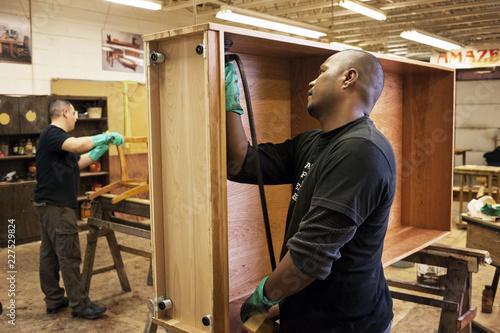 Workers making furniture at workshop