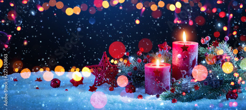 Christmas Decorations With Candles and Colored Lights Effects Canvas Print