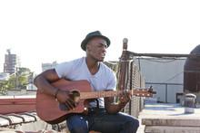 Man Singing While Playing Guit...