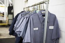 Uniforms Hanging On Coat Hange...