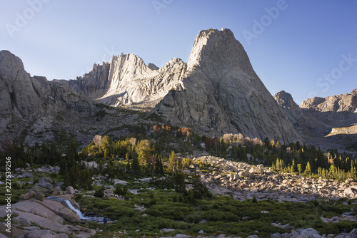 Scenic view of mountains against clear sky on sunny day