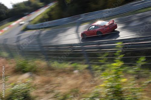 Fotografía  Sportwagen auf der Nordschleife - Stockfoto