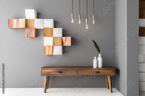 Fotografering Gray and wooden tiles living room, cabinet