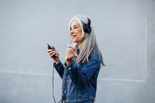 Senior Woman With Grey Long Hair Wearing Denim Jacket.