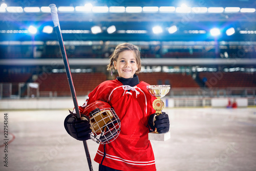 happy girl player ice hockey winner trophy.