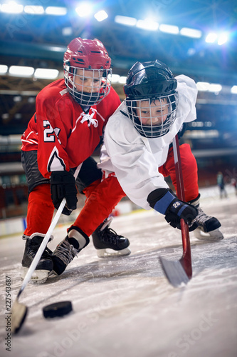 Ice hockey player in sport action on the ice.