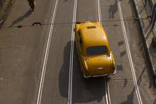Yellow Coloured Taxi In The Street Of Kolkata