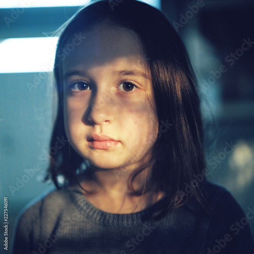Moody portrait of a young girl