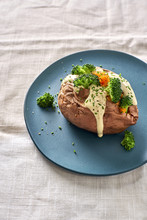 Baked Potato With Cheese Sauce Broccoli And Chives