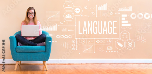 Language with young woman using her laptop in a chair Fotobehang