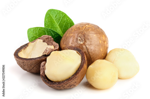 obraz lub plakat Shelled and unshelled macadamia nuts with leaves isolated on white background
