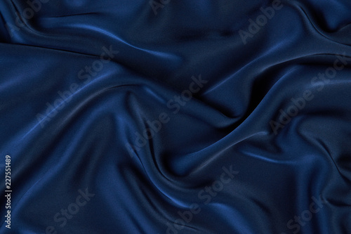 Photo Dark blue silk fabric background, view from above