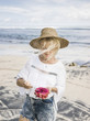 Young traveler enjoying tropical fruit on beach