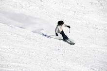 A Skier On Slope In Ski Field