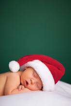 Christmas Newborn Baby Wearing Santa Hat And Sleeping