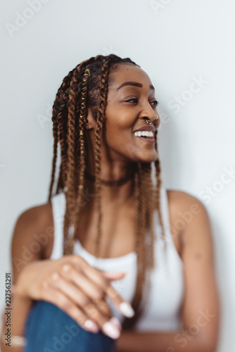Portraits of a young black woman at home