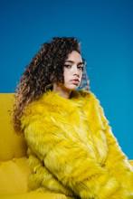 Curly Woman In Yellow Fur Coat