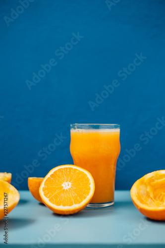 Orange juice on blue background