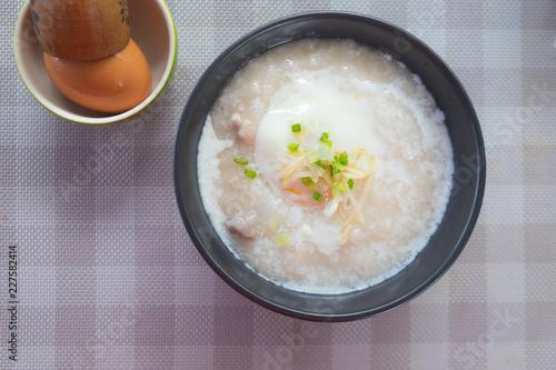Rice porridge with pork egg sliced ginger and vegetable