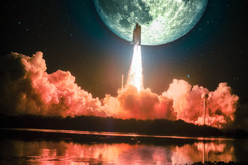 Lighting up the night sky, as well as the water nearby, spacship blazes into the moon mission. Huge moon is on the night sky surrounding by galaxy. Elements of this image furnished by NASA.