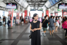 Woman Standing At Metro Station